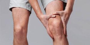 Image of customer holding an injured knee